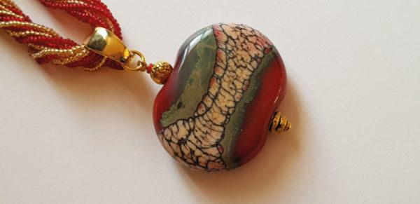Perle plate rouge en verre de murano